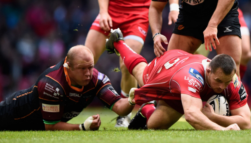 Brok Harris makes a desperate tackle on the ground