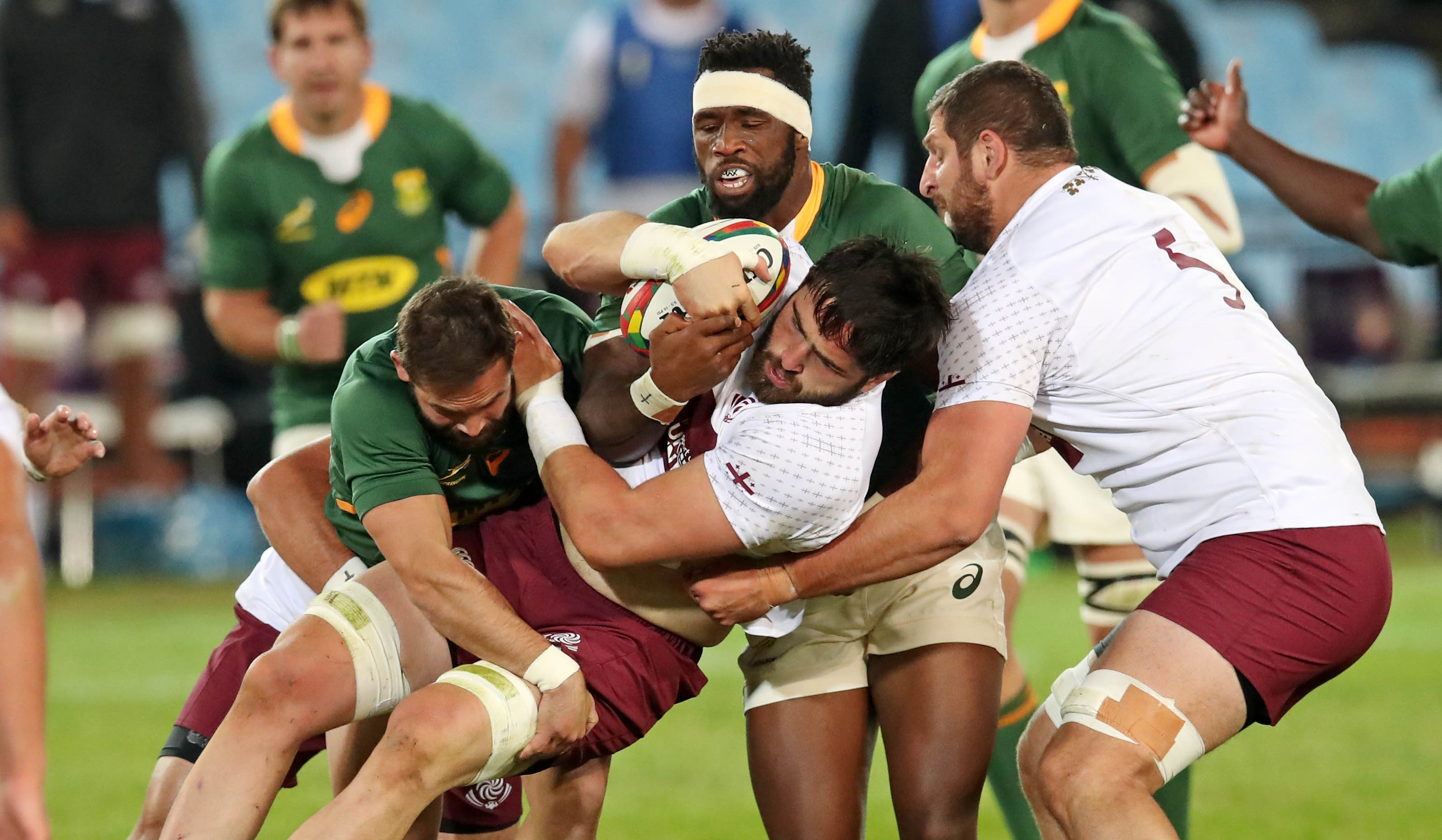 Beka Saginadze of Georgia is tackled by Cobus Reinach and Siya Kolisi of South Africa during the 2021 International Test Match Rugby Series between South Africa and Georgia at Loftus Stadium, Pretoria on 02 July 2021 ©Gavin Barker/BackpagePix