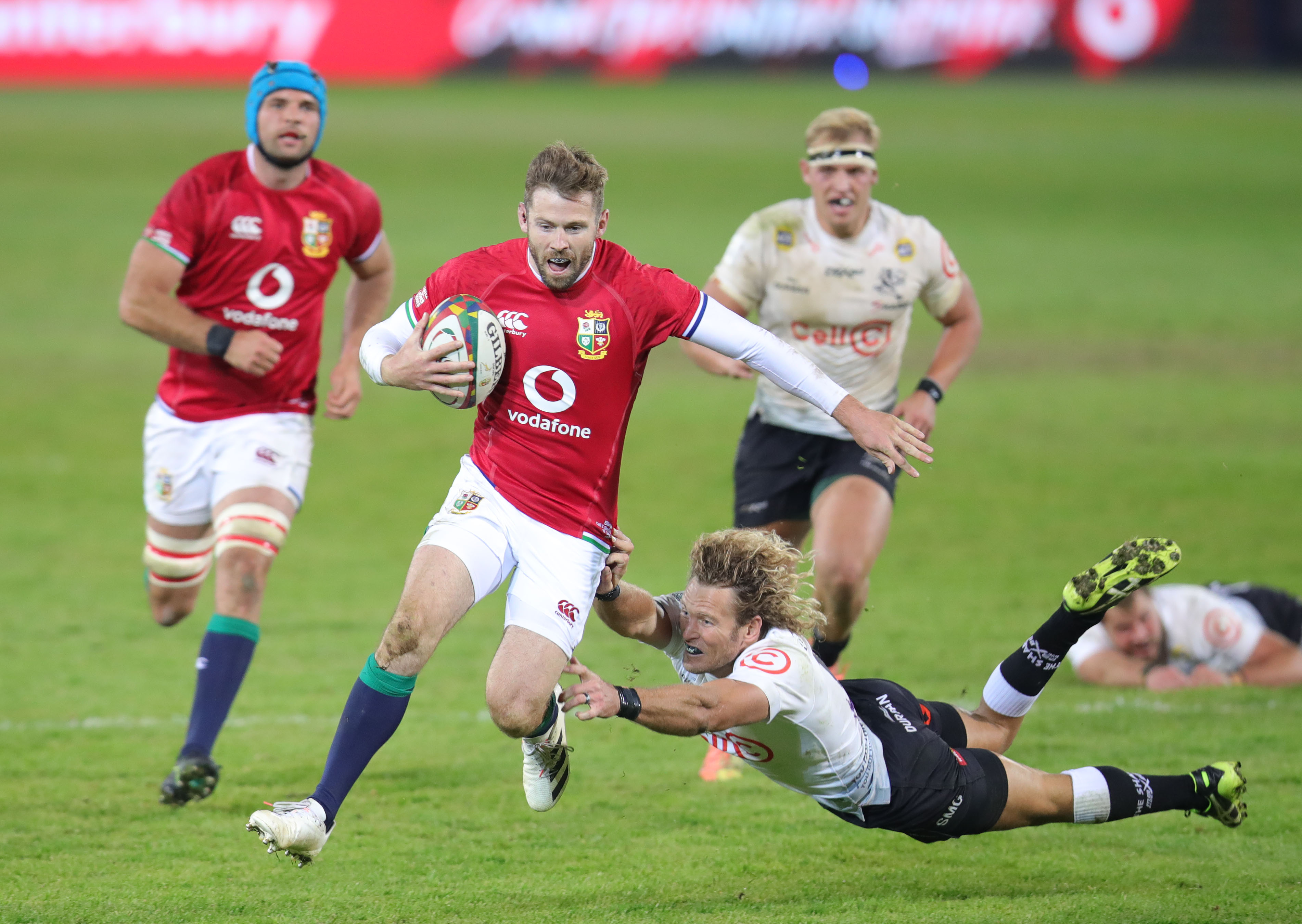 Elliot Daly of the BI Lions evades a tackle from Werner Kok of the Sharks during the 2021 British and Irish Lions Tour rugby match between the Sharks and BI Lions at Loftus Stadium, Pretoria on 10 July 2021 ©Muzi Ntombela/BackpagePix