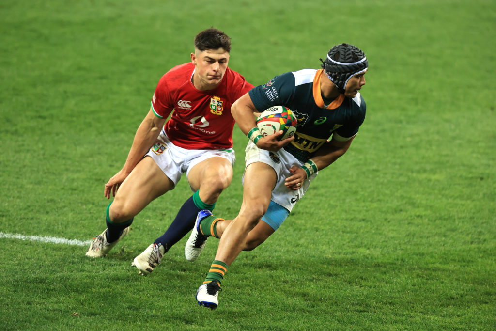 CAPE TOWN, SOUTH AFRICA - JULY 14: British & Irish Lions player Louis Rees-Zammit is beaten by South Africa A wing Cheslin Kolbe during the match between South Africa A and the British and Irish Lions at Cape Town Stadium on July 14, 2021 in Cape Town, South Africa.