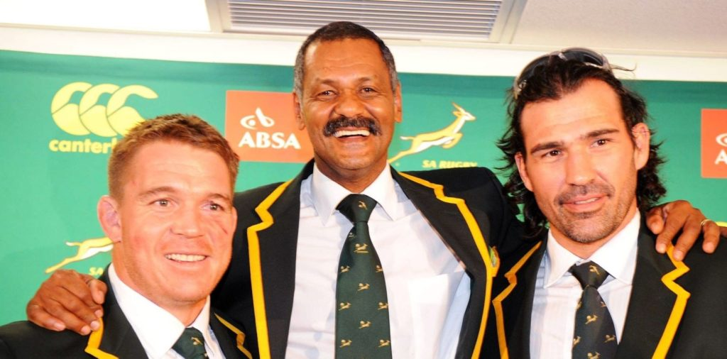 JOHANNESBURG, SOUTH AFRICA - OCTOBER 10: (L-R) John Smit, coach Peter de Villiers and Victor Matfield of South Africa pose during the Springboks Arrival Media Conference at OR Tambo International Airport on October 10, 2011 in Johannesburg, South Africa. (Photo by Lee Warren/Gallo Images/Getty Images)