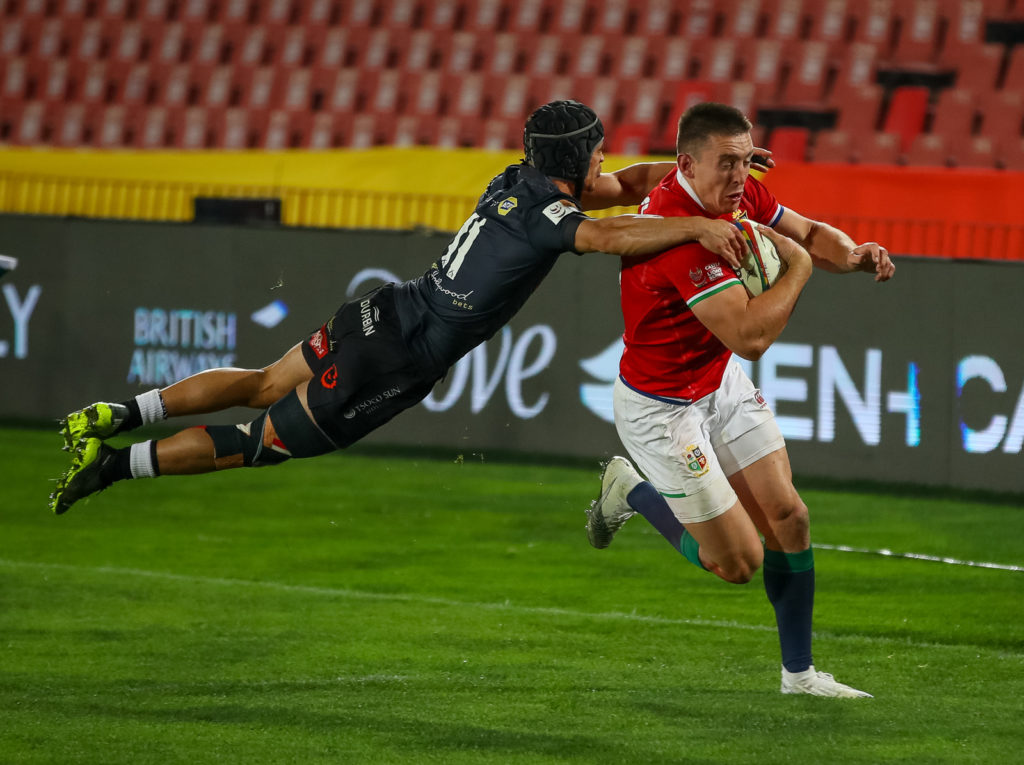 SOUTH AFRICA - JULY 07: Valiant effort from Thaakir Abrahams of the Cell C Sharks to tackle the try scorer Josh Adams of the British & Irish Lions during the Tour match between Cell C Sharks and British and Irish Lions at Emirates Airline Park on July 07, 2021 in Johannesburg, South Africa.