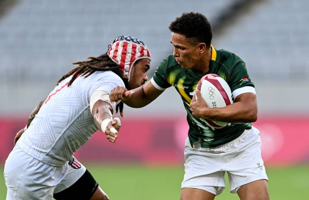 Tokyo , Japan - 28 July 2021; Ronald Brown of South Africa is tackled by Folau Niua of United States during the Men's Rugby Sevens 5th placed play-off match between USA and South Africa at the Tokyo Stadium during the 2020 Tokyo Summer Olympic Games in Tokyo, Japan.