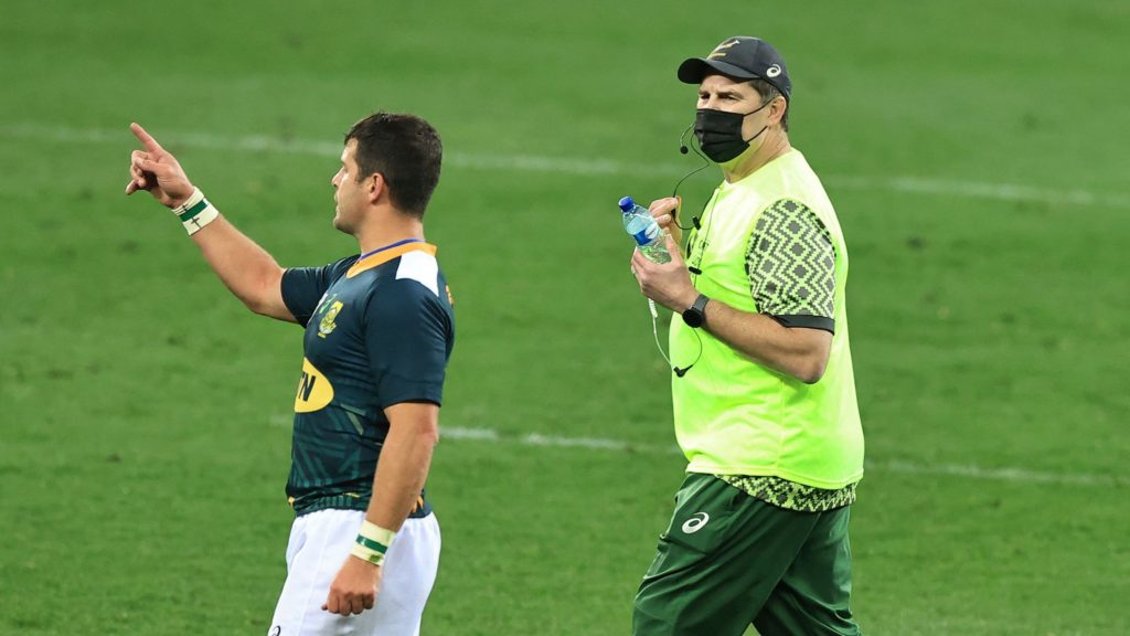 CAPE TOWN, SOUTH AFRICA - JULY 14: Rassie Erasmus, the South Africa Springbok head coach, acts as a water carrier during the match between South Africa A and the British & Irish Lions at Cape Town Stadium on July 14, 2021 in Cape Town, South Africa. (Photo by David Rogers/Getty Images)