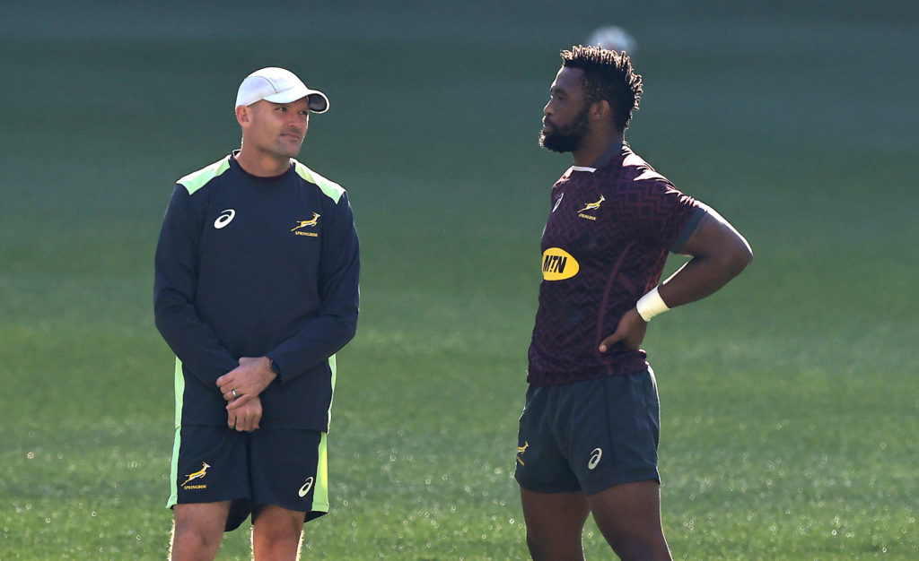 CAPE TOWN, SOUTH AFRICA - AUGUST 06: Siya Kolisi, (R) the South Africa captain, talks to head coach Jacques Nienaber during the South Africa Springboks captain's run at Cape Town Stadium on August 06, 2021 in Cape Town, South Africa.