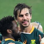 South Africa's lock Eben Etzebeth (R) and South Africa's blindside flanker and captain Siya Kolisi celebrate after victory with teammates in the third rugby union Test match between South Africa and the British and Irish Lions at The Cape Town Stadium in Cape Town on August 7, 2021. (Photo by RODGER BOSCH / AFP) (Photo by RODGER BOSCH/AFP via Getty Images)