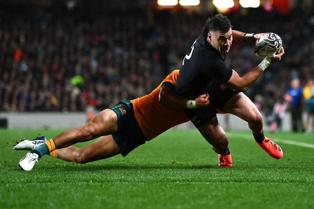 AUCKLAND, NEW ZEALAND - AUGUST 07: David Havili of the All Blacks is tackled as he moves towards the try line during the Rugby Championship and Bledisloe Cup match between the New Zealand All Blacks and the Australia Wallabies at Eden Park on August 07, 2021 in Auckland, New Zealand.
