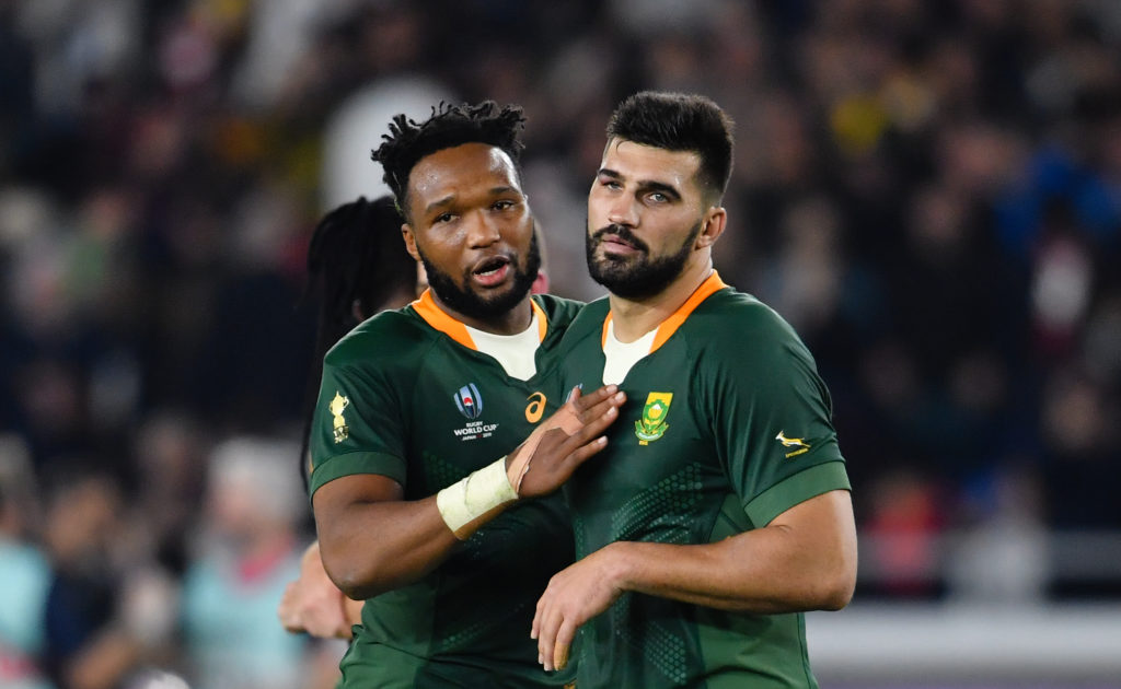 YOKOHAMA, JAPAN - OCTOBER 27: South Africa's Lukhanyo Am (l) with Damian de Allende after their 19-16 victory in the Rugby World Cup 2019 Semi-Final match against Wales at International Stadium Yokohama on October 27, 2019 in Yokohama, Kanagawa, Japan.