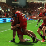 BRISTOL, ENGLAND - SEPTEMBER 17: Alex Lewington of Saracens is mobbed by team mates after scoring the match winning try during the Gallagher Premiership Rugby match between Bristol Bears and Saracens at Ashton Gate on September 17, 2021 in Bristol, England.