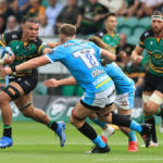 NORTHAMPTON, ENGLAND - SEPTEMBER 18: Juarno Augustus of Northampton Saints holds off Jack Clement during the Gallagher Premiership Rugby match between Northampton Saints and Gloucester Rugby at Franklin's Gardens on September 18, 2021 in Northampton, England.