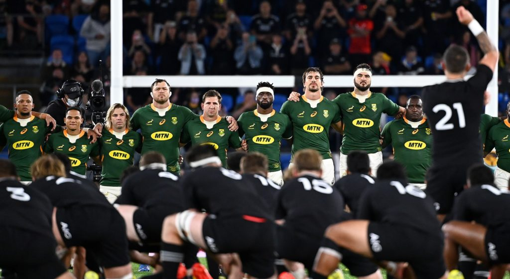 epa09501260 South African players look on as T J Perenara leads the All Black Haka during Round 6 of the Rugby Championship match between South Africa's Springboks and New Zealand's All Blacks at CBus Stadiumon on the Gold Coast, Queensland, Australia, 02 October 2021.