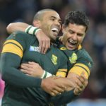 South Africa's wing Bryan Habana (L) celebrates with South Africa's fly half Morne Steyn after scoring his second and his team's sixth try during a Pool B match of the 2015 Rugby World Cup between South Africa and USA at the Olympic Stadium, east London, on October 7, 2015. AFP PHOTO / GLYN KIRK RESTRICTED TO EDITORIAL USE, NO USE IN LIVE MATCH TRACKING SERVICES, TO BE USED AS NON-SEQUENTIAL STILLS