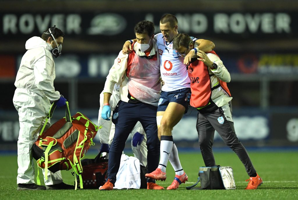 Mandatory Credit: Photo by Ben Evans/Huw Evans/Shutterstock/BackpagePix (12531067s) Johan Goosen of Bulls leaves the field with medical staff. Cardiff Rugby v Vodacom Bulls - United Rugby Championship - 09 Oct 2021