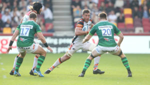 BRENTFORD, ENGLAND - OCTOBER 09: Leicester Tigers's Hanro Liebenberg takes on London Irish's George Nott during the Gallagher Premiership Rugby match between London Irish and Leicester Tigers at Brentford Community Stadium on October 9, 2021 in Brentford, England.