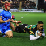 NORTHAMPTON, ENGLAND - OCTOBER 22: Courtnall Skosan of Northampton Saints dives to score his first of three tries during the Gallagher Premiership Rugby match between Northampton Saints and Worcester Warriors at Franklin's Gardens on October 22, 2021 in Northampton, England.